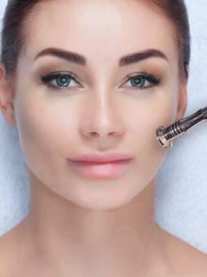 the-cosmetologist-makes-the-procedure-microdermabrasion-of-the-facial-skin-of-a-beautiful-young-woman-in-a-beauty-salon